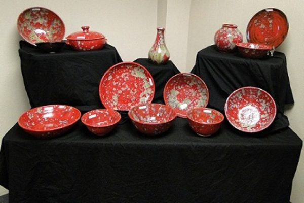 Pottery and Art Sale red display